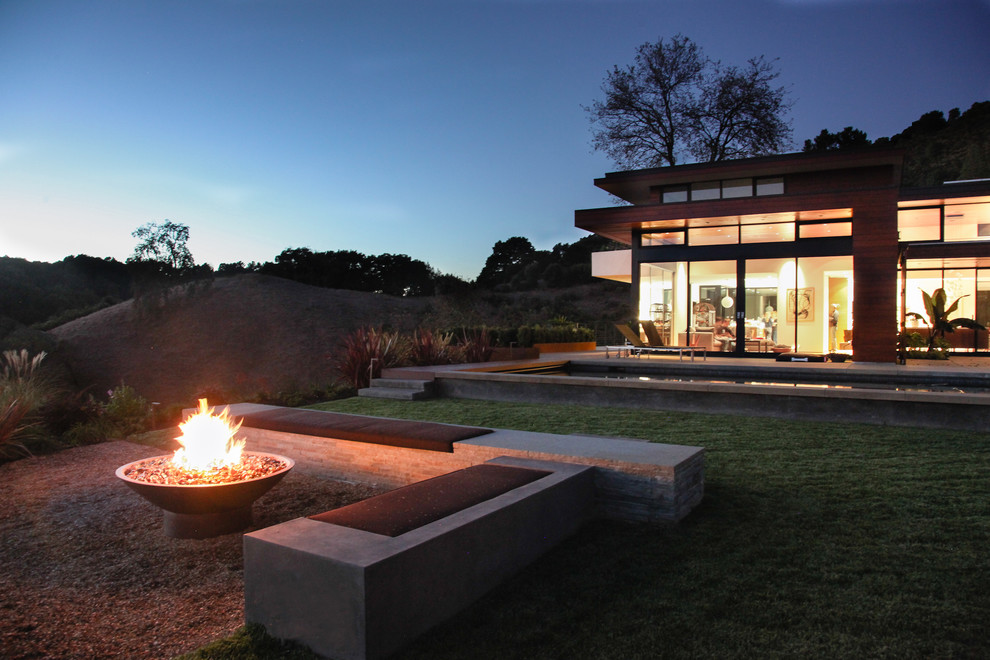 cast-iron-fire-pit-in-landscape-modern-with-concrete-patio-bench-7